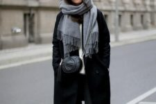 13 black skinnies, a white sweater, black Chelsea boots, a black coat, a grey scarf and a black bag