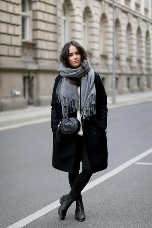 black skinnies, a white sweater, black Chelsea boots, a black coat, a grey scarf and a black bag