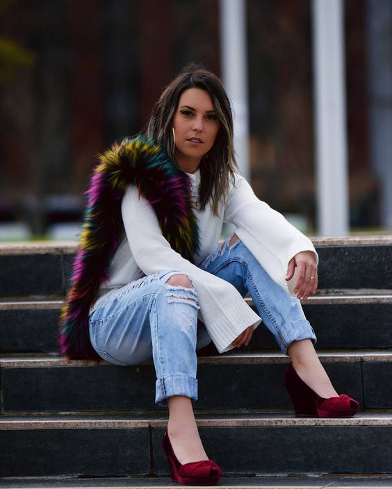 blue ripped denim, a white bell sleeve short, red wedges and a colorful faux fur scarf