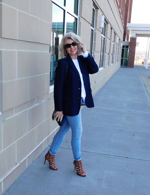 blue skinnies, a white shirt, a navy blazer, brown strappy heels and a little bag