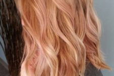 13 rose gold wavy hair with strawberry blonde highlights are a chic and very girlish idea