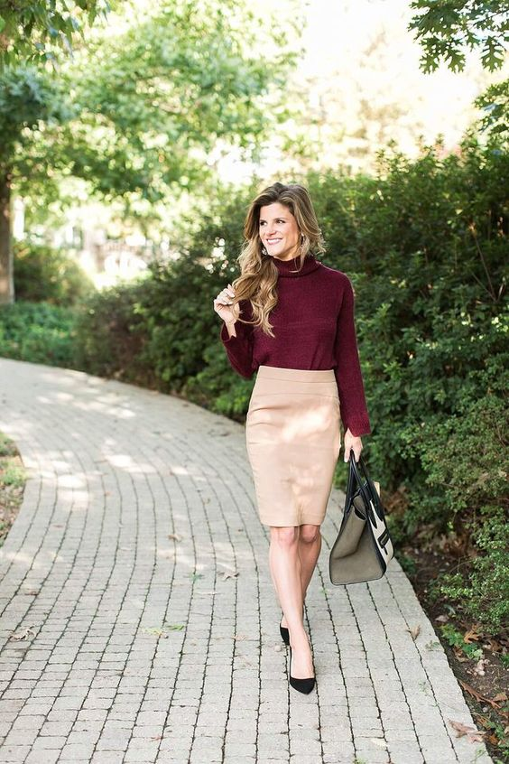 a neutral pencil skirt, a burgundy turtleneck, black heels and a neutral bag