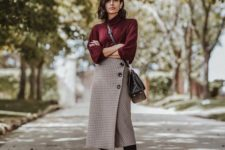 14 a plum-colored turtleneck, a plaid pencil midi skirt with buttons, black boots and a black bag