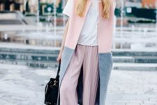 14 a trendy look with a white tee, blush cropped pants, a sleeveless pink and grey coat plus black