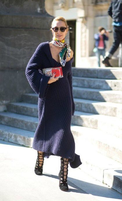 a wow look with a one shoulder navy midi dress, a bright clutch and scarf and lace up boots