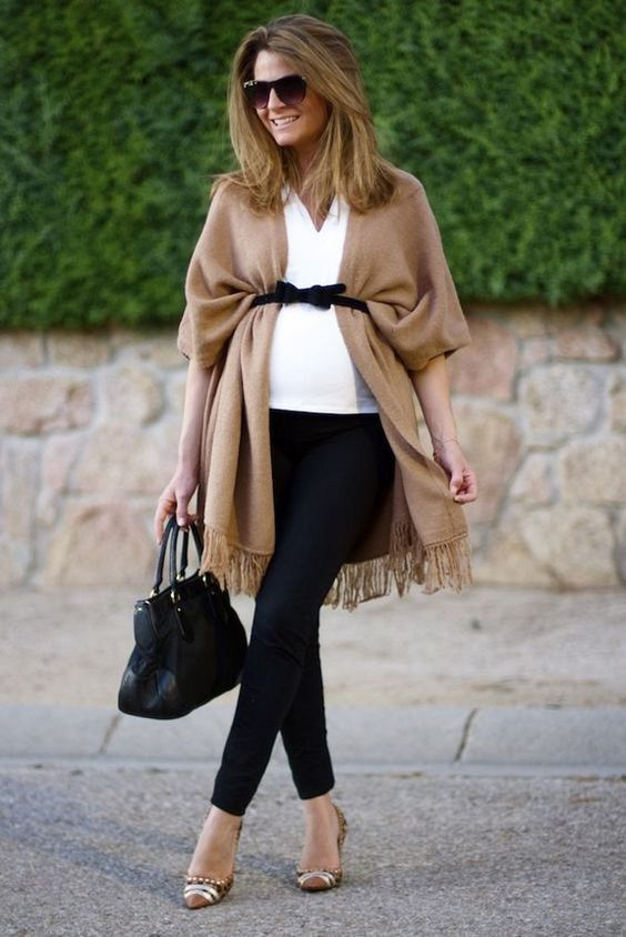 black pants, a white top, a beige coverup, a black bag and printed shoes for a stylish and comfortable look