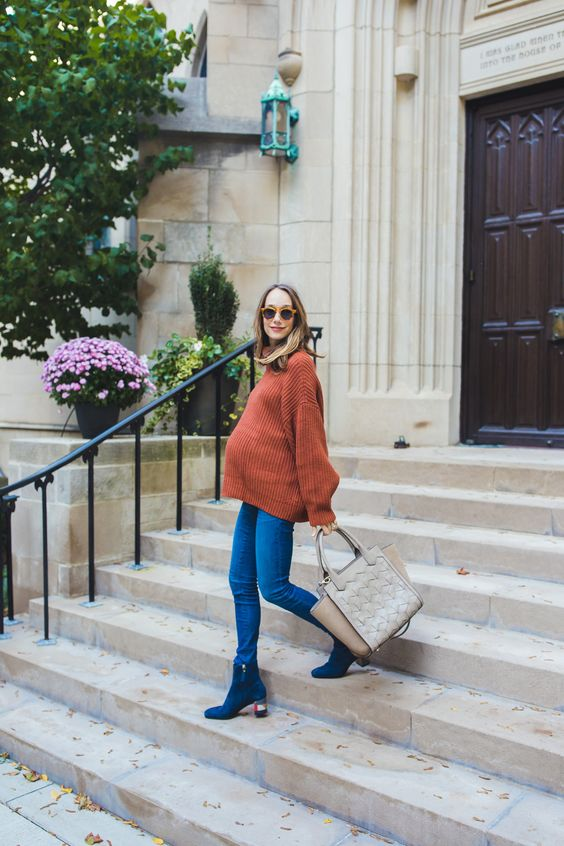 blue skinnies, an oversized rust sweater, electric blue booties and a grey bag for a casual Thanksgiving look