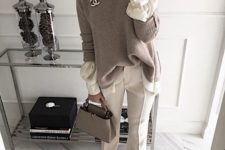 14 creamy pants and a long sleeved shirt with pearl sleeves, a neutral oversized sweater and a grey bag