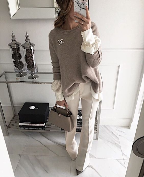 creamy pants and a long sleeved shirt with pearl sleeves, a neutral oversized sweater and a grey bag