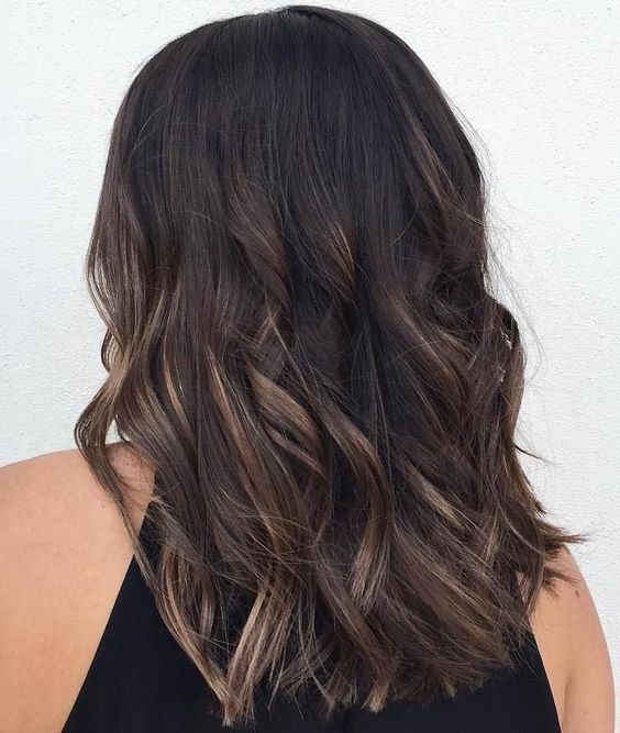 deep brown black hair with bronde balayage is a great darker tone idea with a dimension and texture