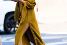 15 a mustard sweater dress with a side slit on a zip and black boots with a wow factor