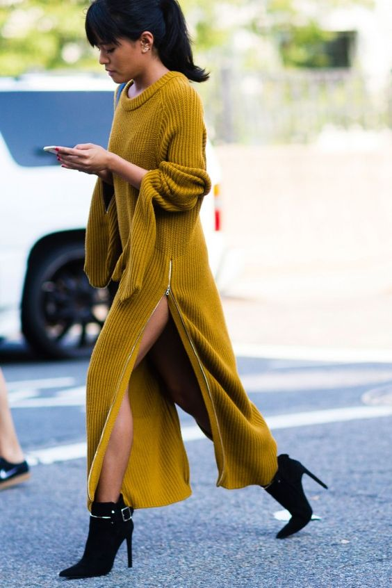a mustard sweater dress with a side slit on a zip and black boots with a wow factor