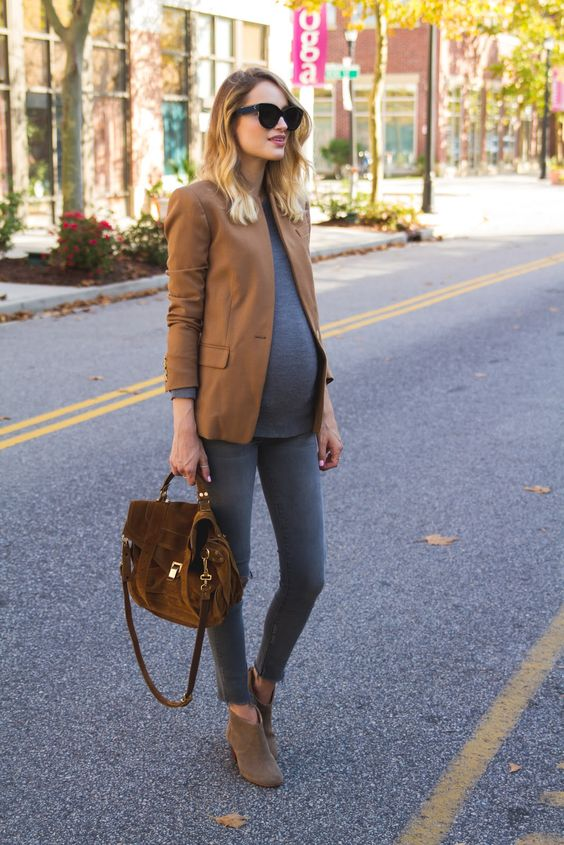grey skinnies, a grey long sleeve top, a camel blazer, beige booties and a brown bag