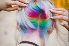 15 long icy blonde hair with rainbow peekaboo highlights for a bright statement