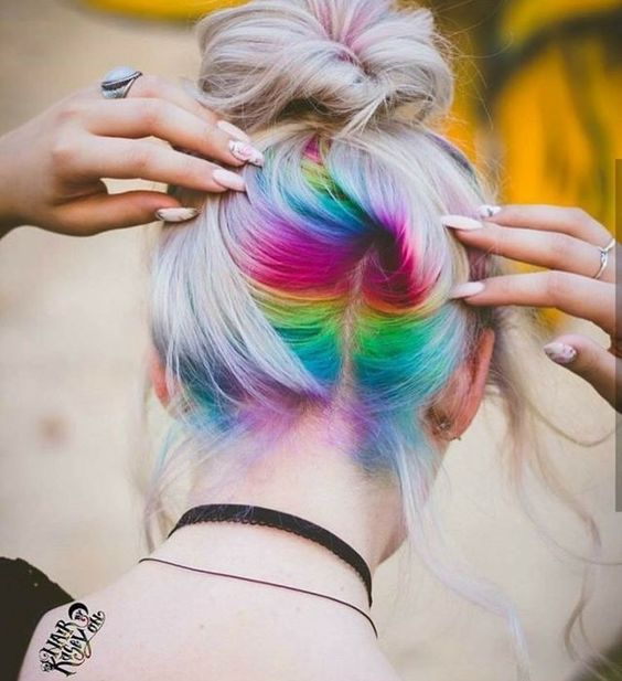 long icy blonde hair with rainbow peekaboo highlights for a bright statement