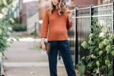 15 navy pants, a rust sweater, nude tassel heels and a leopard clutch for fall or Thanksgiving