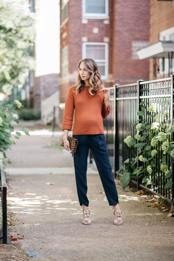navy pants, a rust sweater, nude tassel heels and a leopard clutch for fall or Thanksgiving