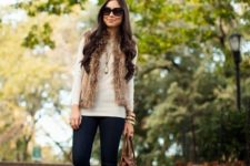 15 navy skinnies, a neutral long sleeve top, beige booties and a brown chunky fur waistcoat