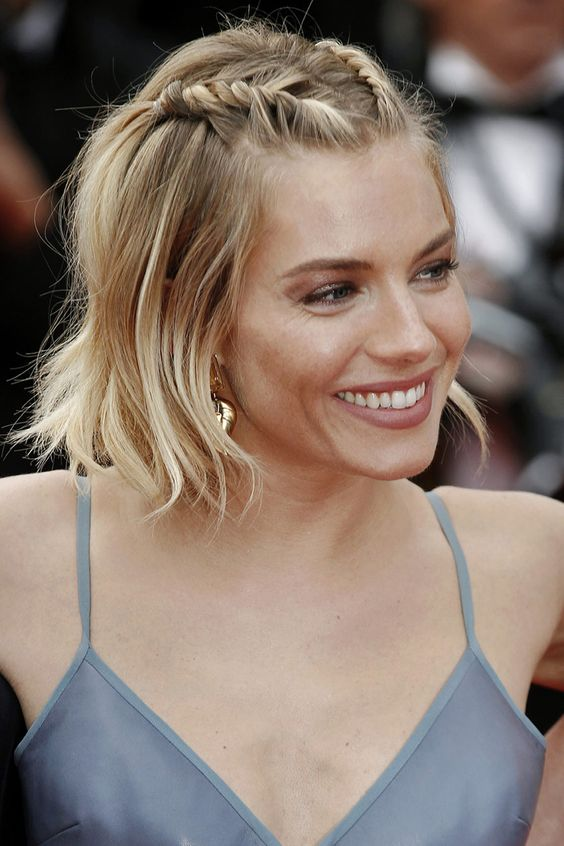 Sienna Miller rocking a short bob and two twisted braids on top and looks gorgeous