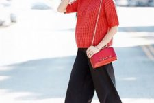 16 a coral short sleeve sweater, black culottes, a red bag and heels for a bold and bright look