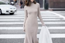 16 a neutral turtleneck midi knit dress, white sneakers and a white faux fur coat