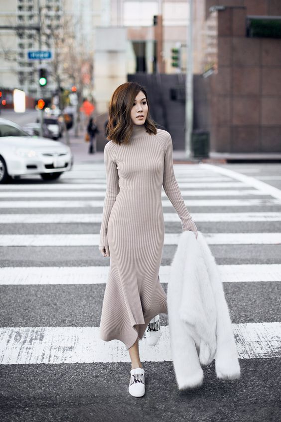 a neutral turtleneck midi knit dress, white sneakers and a white faux fur coat