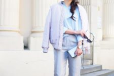 16 grey pants, a blue shirt, a lavender bomber jacket and white sneakers