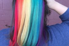 16 medium length black hair with rainbow peekaboo highlights that impress