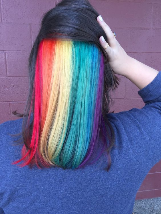 Picture Of Medium Length Black Hair With Rainbow Peekaboo Highlights