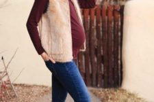 16 navy skinnies, a burgundy long sleeve top, a faux fur waistcoat, brown moccasins and a neutral hat