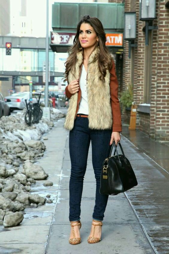 navy skinnies, a white tee, mustard shoes, a rust leather jacket and a faux fur waistcoat