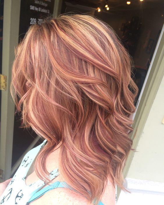 wavy auburn cascading haircut with strawberry blonde highlights is a creative idea