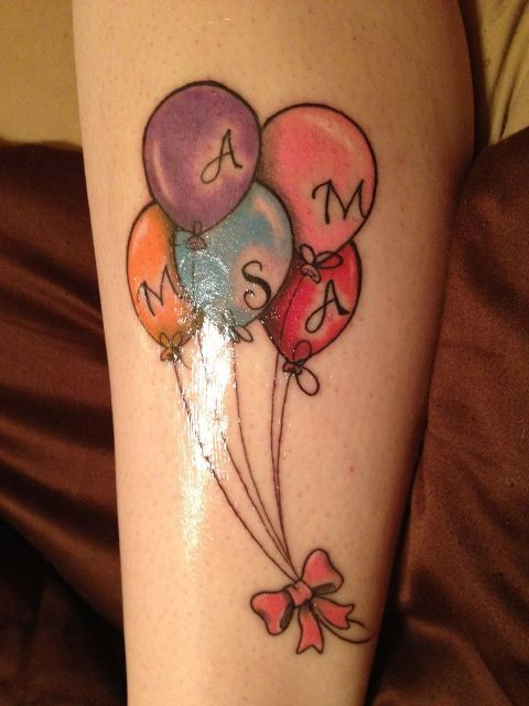 Balloons and bow tattoo idea