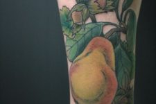 Big pear tattoo on the leg