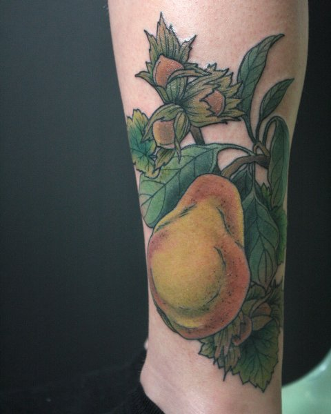 Big pear tattoo on the leg