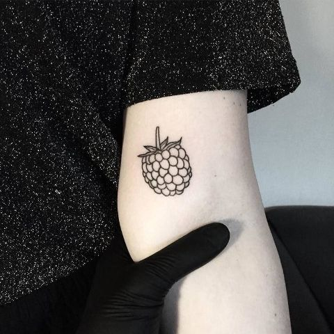 Black-contour berry tattoo design