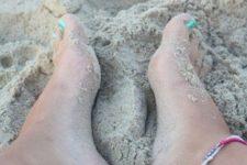 Black-contour tattoos on the feet