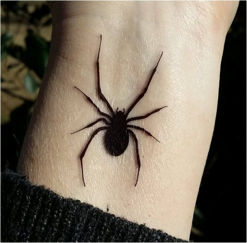 Black spider tattoo idea