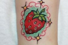 Cartoon strawberry tattoo