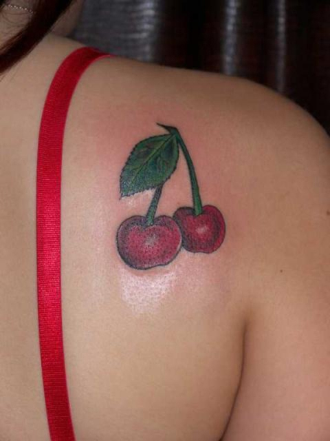 Classic cherry tattoo design on the shoulder
