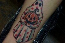 Colorful tattoo with a ghost and a pumpkin