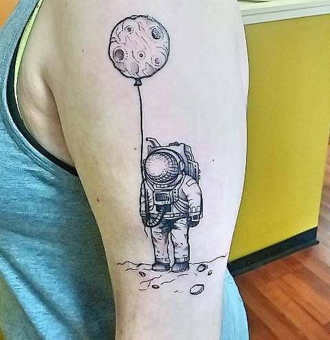 Cool astronaut with balloon tattoo