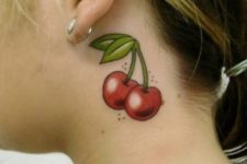 cute neck tattoo with cherry berries