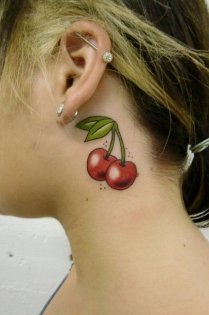 Cute cherry tattoo on the neck