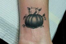 Cute gray pumpkin tattoo on the wrist