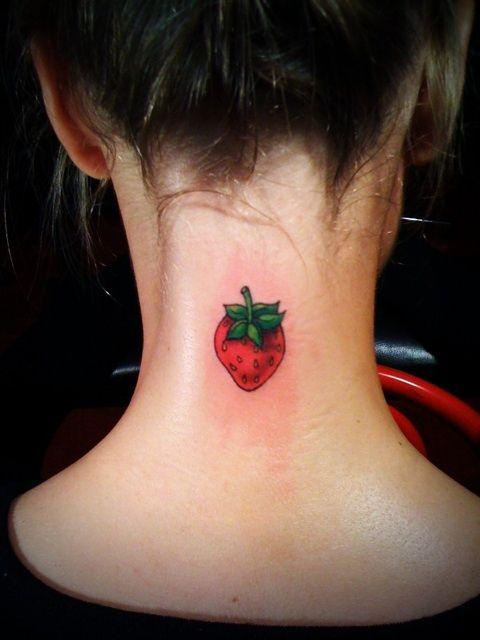 Cute strawberry tattoo on the neck