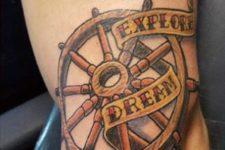 Explore, dream, discover tattoo on the leg