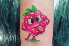 Funny raspberry tattoo on the wrist