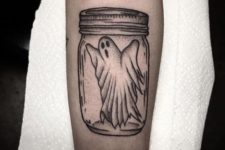 Ghost in jar tattoo on the arm