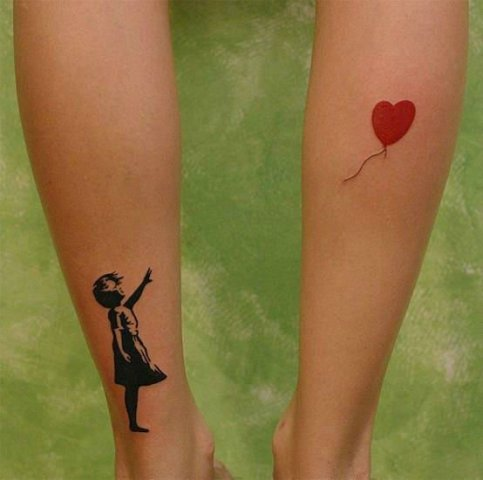 Girl with a red heart shaped balloon tattoo on the both legs